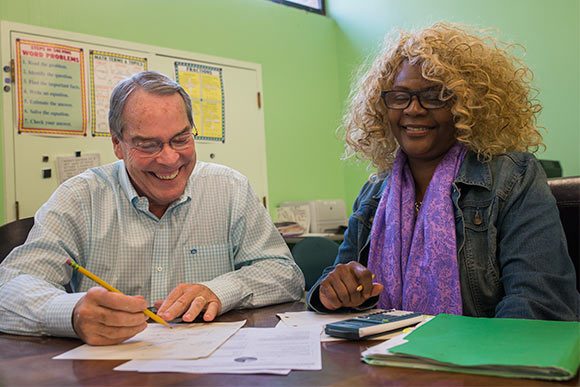 Bruce Smith volunteer adult educator working with Carrie Gary at May Dugan Center's Education Resources Center