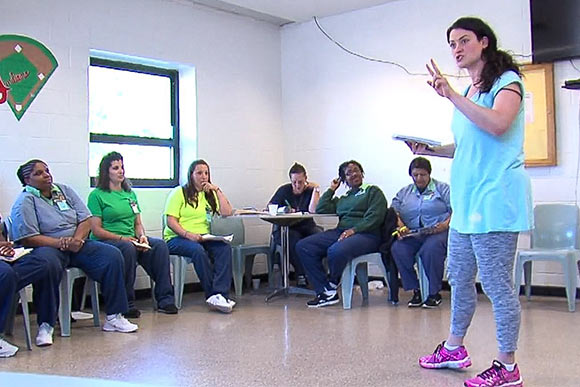 Lara Mielcarek directing inmates at Cleveland's Northeast Reintegration Center