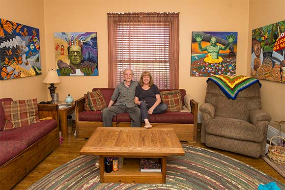 "Gary and Laura Dumm at their home surrounded by ""Monsters"""