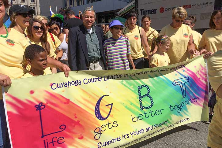 Division of Children and Family Services staff and adoptive parents/kids marched in the Pride Parade