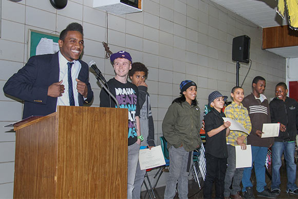 Ja�Ovvoni Garrison hosting the award ceremony for the Skaters Next Door program in 2011 at the Annual Neighborhood Summit in Slavic Village
