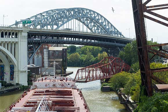 Center Street Bridge in operation letting the vessel American Courage pass down the river