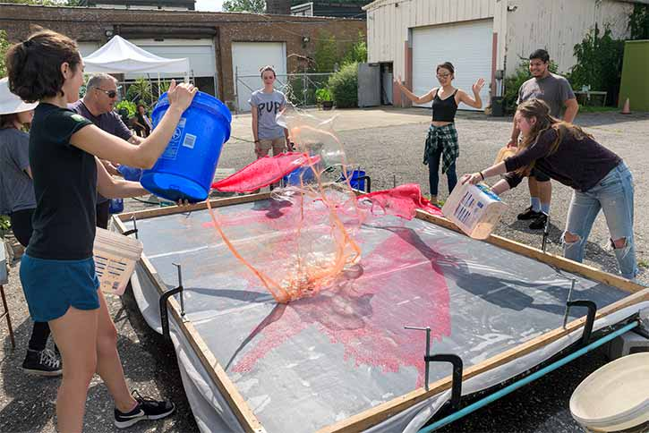 Resident artist Hong Hong teaches the Conservatory's Summer 2017 interns techniques used in creating her signature large-scale paper pours