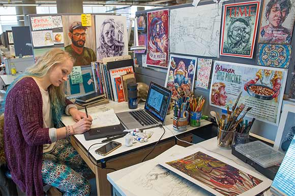 Sophomore Illustration major Erika Grauzinis working on a sketch at her workplace at CIA