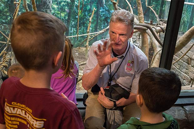 Curator Tad Schoffner talks monkeys with children visitors to the Cleveland Metroparks Zoo
