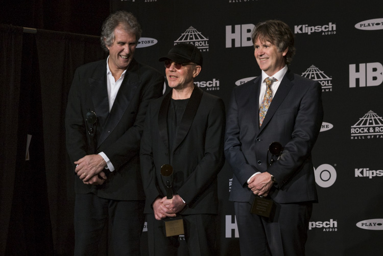 Members of Dire Straits backstage at the 33rd Rock & Roll Hall of Fame Induction Ceremony