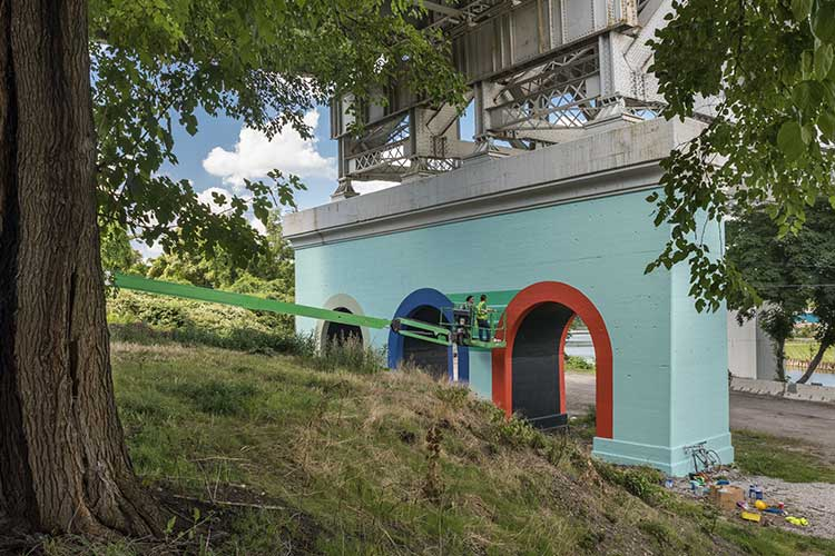 LAND studio sponsored mural by Agnes Studio - Inter| urban project on the RTA railroad bridge abutment