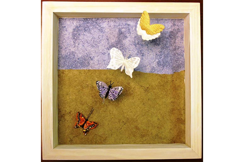 Butterfly shadowbox made by a woman who was the primary caregiver for her mother