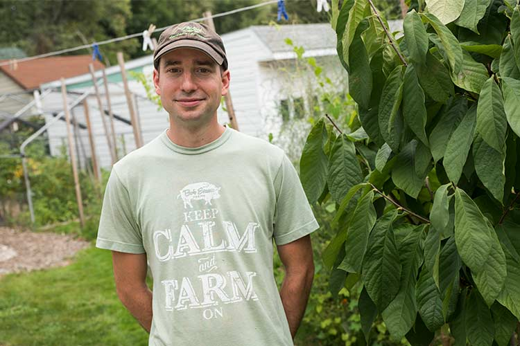 Ronald Kasper of Orchard Grove CSA next to his Pawpaw fruit tree