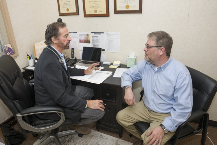 Medical Director Rick Frires, MD and Founder Drew Reimer of Caritas Treatment and Wellness Center