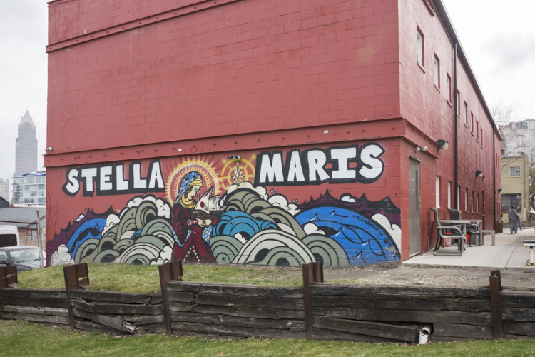 Mural by artist Kali Gibbons on the back of the supportive housing bat the Stella Maris Campus