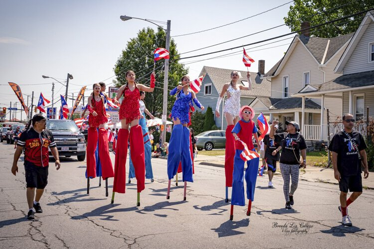 The Puerto Rican Parade and Festival hits the street.