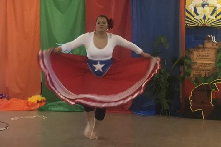 Bianca Sorace performs a salsa dance at Hasani Management.