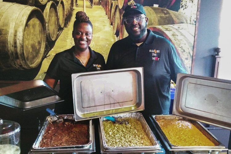 Kurtis Williams (right) with Candace Maiden, co-owners of Squash the Beef, a vegan comfort food caterer.