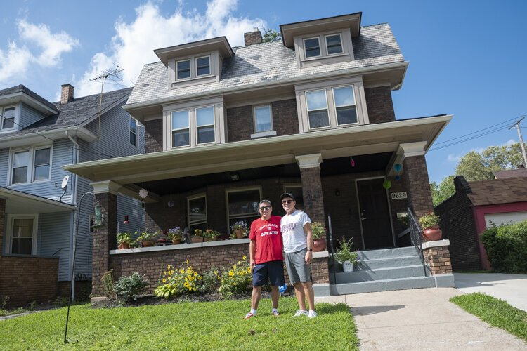 Todd Barr and Dane Vanatter in front of their home in Glenville