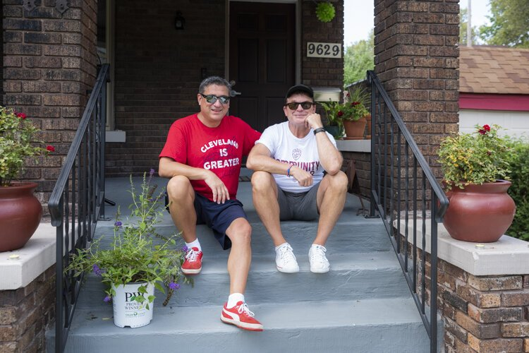 Todd Barr and Dane Vanatter on the front steps of their home in Glenville