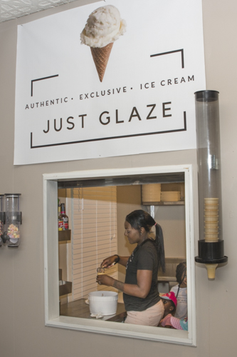 LaToyia Glaze scooping up some of their signature ice cream