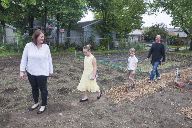The Gutierrez Family checking out their garden at the  Ben Franklin Community Garden