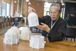 Thomas Zung with a model of his cage design