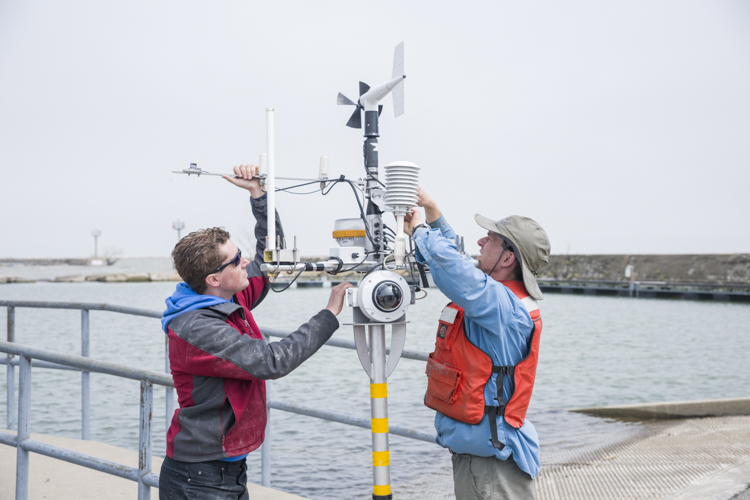 LimnoTech Project Engineer Ed Verhamme and scientist Greg Cutrell making preparations for the buoy release