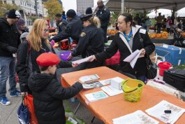 City of Cleveland Department of Public Health Case Manager Linda Provitt-Robinson distributes lead poisoning information at a recent event in Public Square.