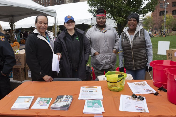 Cleveland Department of Public Health workers Linda Provitt-Robinson, Claudia Meister, Tyra Kirby and Charlotte Ford distribute lead poisoning information at a recent event in Public Square.
