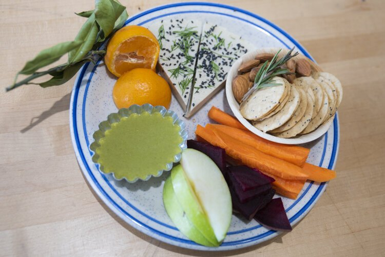 Baba Yaga's cheese plate - House made Vegan Gluten Free/ Soy free / Nut free Smoked Provolone with a Carrot top pesto, gluten free crackers, satsuma orange, almonds, carrots.