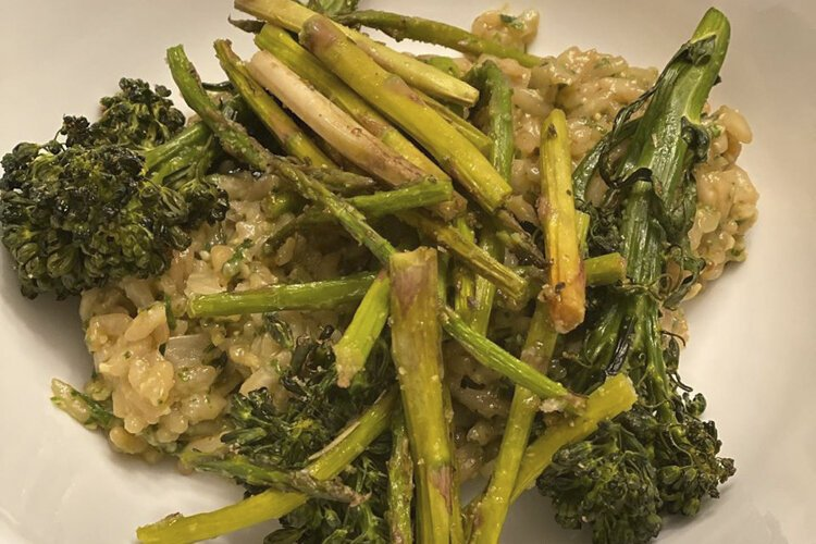 Birch Café oven baked pesto risotto topped with roasted broccolini and asparagus