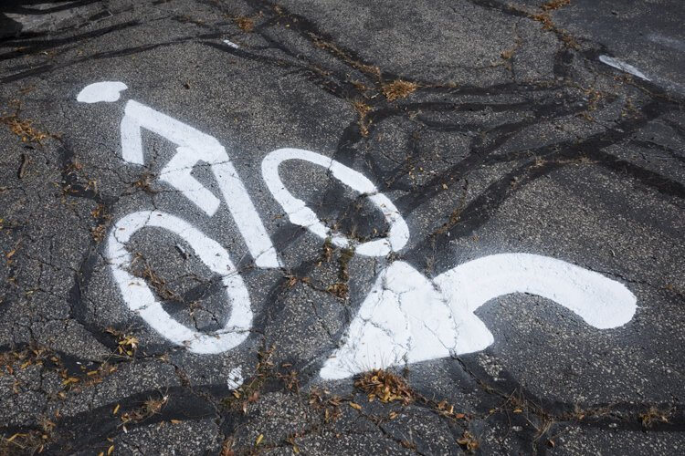 A bicyclist symbol and an arrow were printed at a recent test in Cleveland Heights.