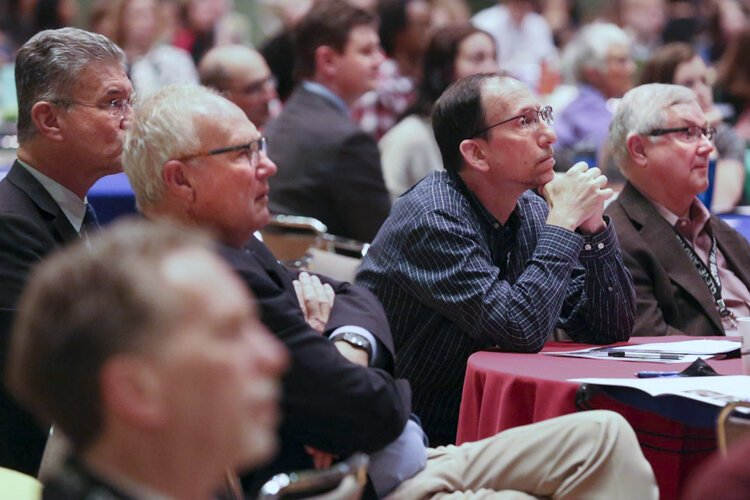 David Beach, chin on hands, listens during the final event of Sustainable Cleveland 2019 on Oct. 16 in Public Auditorium.
