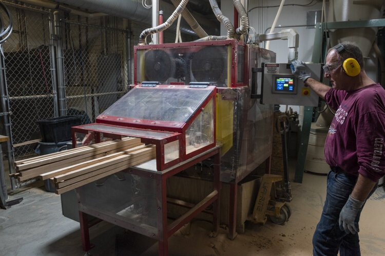 MAGNET built a robot for Cleveland Whiskey that cuts wood into perfect one-inch squares, so the engineers can do their true work.