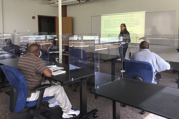 MAGNET constructed a specially designed classroom with plexiglass dividers, temperature checks, and strict sanitation practices for their manufacturing training program classes.