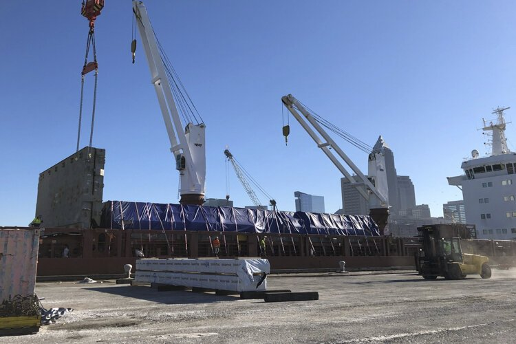 Timber headed for the construction site for INTRO being unloaded at the Port of Cleveland.