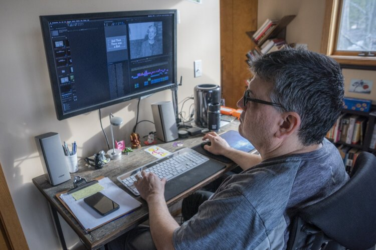 Brad Masi works on video editing at his home in Cleveland Heights.