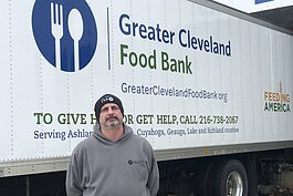 John Daniel Aylward (b.k.a., JD) drives a delivery truck for the Greater Cleveland Food Bank.