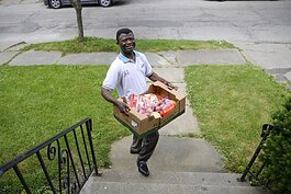 Elijah Kidjana, President of the Congolese Community of Greater Cleveland, distributes food to neighbors on June 11th.