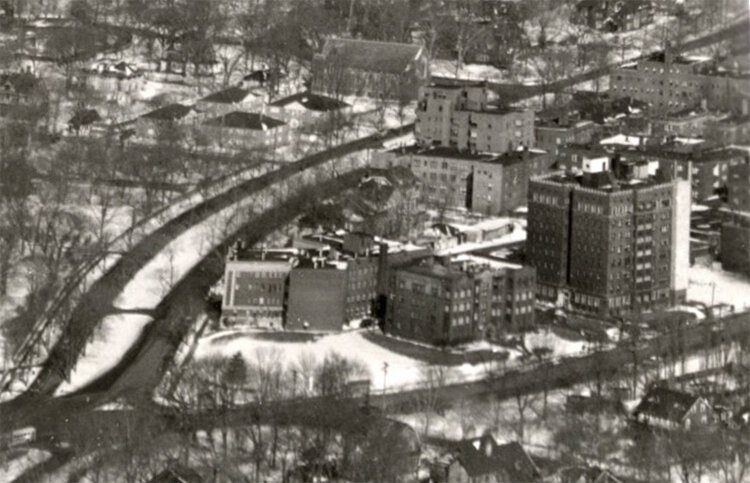 A photo from the 1950s shows the intersection of Cedar and Euclid Heights Boulevard from southwest of the site.
