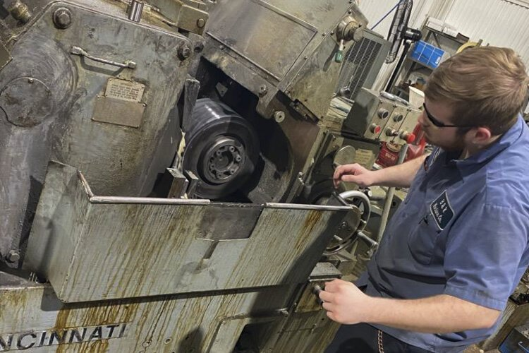 Max Hayes alum William Musselman operating an OD grinder (Outside Diameter grinder) at B & R Machine Co.