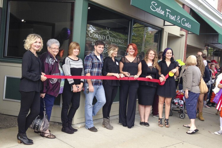 Abigail Brown (6th from left) of Front & Center Salon in Berea.