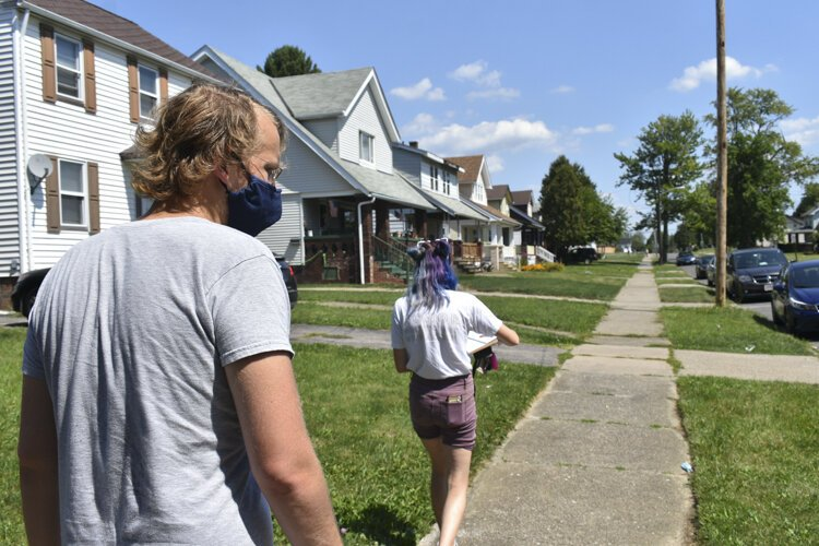 Cleveland DSA members Anna Powaski and Chad Falatic head toward the home of a local renter who faces an eviction case.