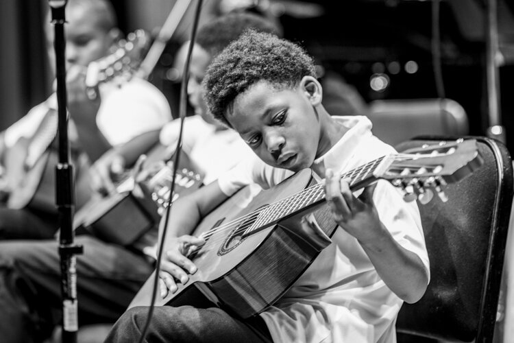 Archie Green created a four-month performance art project called My Violin Weighs a Ton, working with Lexington-Bell Community Center in the Hough neighborhood and with the Cleveland Orchestra and the Cleveland Classical Guitar Society.