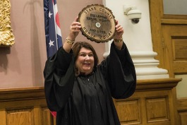 Stark County Common Pleas Judge Taryn Heath displays a plaque presented to her during the Stark county Honor Court.