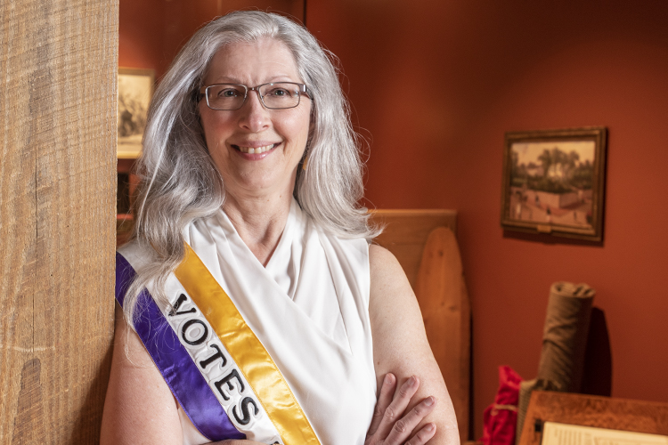 "Durack wears her ""Votes for Women"" sash at the Cincinnati Museum Center."