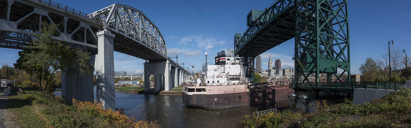 The Sam Laud freighter passing under the Columbus Rd lift bridge <span class='image-credits'>Bob Perkoski</span>