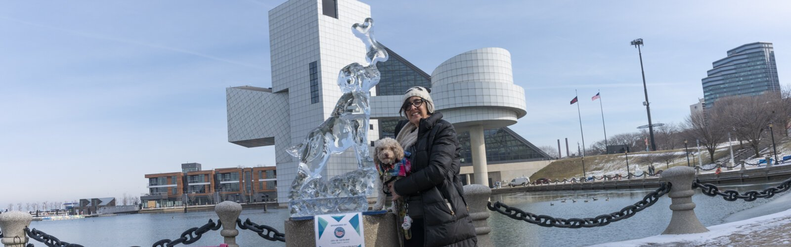 Lakewood resident Joanie and her dog at the North Coast Harbor Ice Fest
