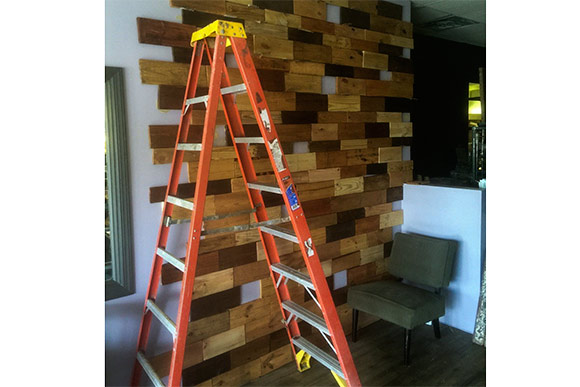 Interior wall of Cafe Avalaun covered with reclaimed pallet wood
