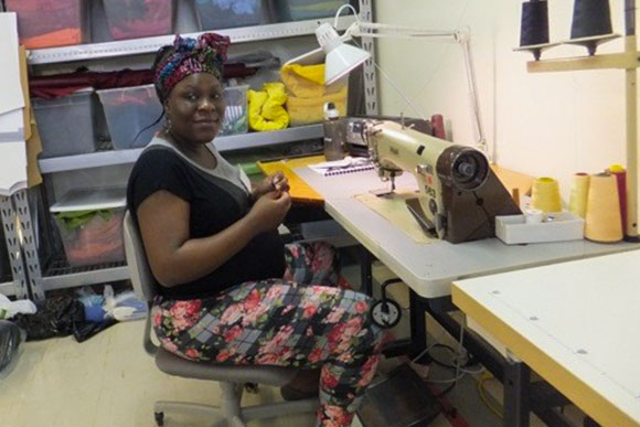 Refugees learn the art of industrial sewing in Esperanza's training program