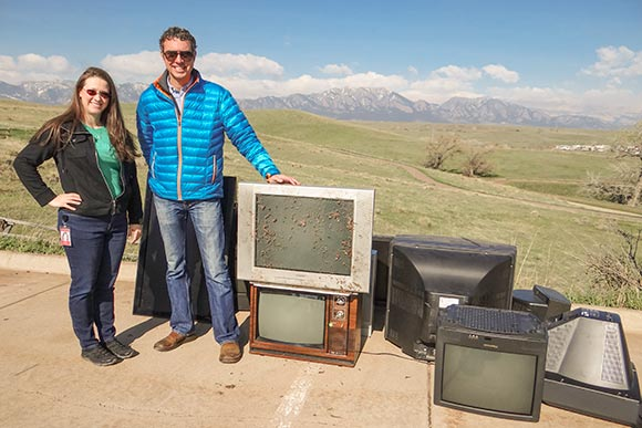 Two KeyBank employees during  e-waste recycling day at Key's Superior, Colorado facility