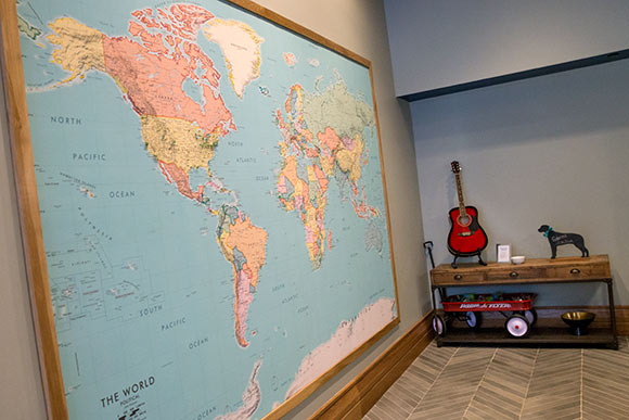 A map of the world is located in the lobby, with push pins for guests to mark their hometowns