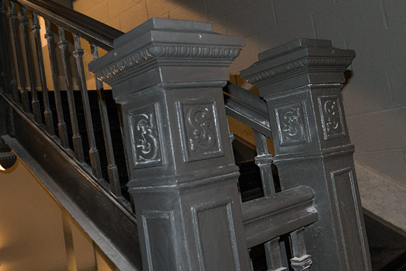 "The center staircase that runs throughout the building and features Schofield's signature ""S"" on each newell post"